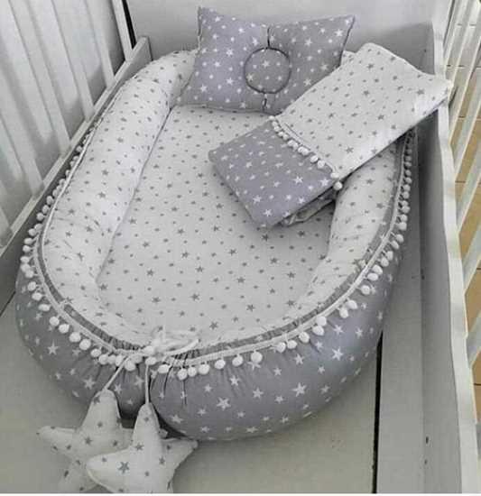 babynest ve battaniye resmi